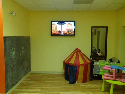TV in daycare area for Inches Fitness